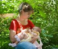 woan in red top breastfeeding